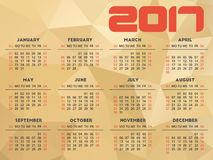 Calendar 2017 design with abstract golden polygonal background. Week starts on Sunday Royalty Free Stock Photography