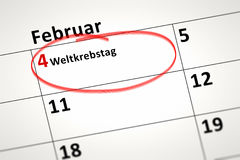 Calendar detail. An image of a calendar detail shows february the 4th World Cancer Day in german language Stock Photography