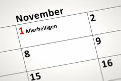 Calendar detail. An image of a calendar detail shows November the first All Saints Day in german language Royalty Free Stock Images