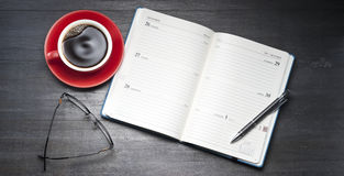 Calendar Diary Organiser Open. An open personal organiser diary with coffee cup, glasses and pen Royalty Free Stock Photography