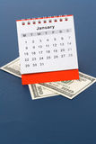 Calendar and dollar Stock Photos