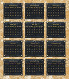 2017 calendar. With each month on a black marble board on a brown stone wall Stock Photo