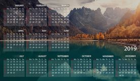 Calendar in English for 2019. Beautiful Mountains Scenery Landscape Dolomites, Landro Lake, Italy. Week starts at Sunday. stock image