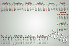 Calendar for 2016 in English and French on pale Stock Images