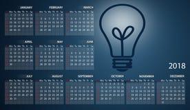 Calendar 2018 in English. Week starts on sunday. Light bulb on dark blue background.  Royalty Free Stock Photos