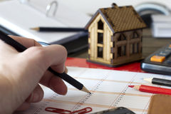 Calendar entry , and small house in the background Stock Image