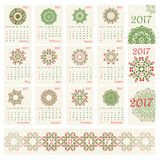 2017 Calendar with ethnic round ornament pattern in red and green colors. Vector illustration. From collection of Balto-Slavic ornaments Stock Illustration