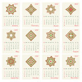 2017 Calendar with ethnic round ornament pattern in red and green colors. Vector illustration. From collection of Balto-Slavic ornaments Vector Illustration