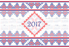 2017 Calendar with ethnic round ornament pattern in white red blue colors Royalty Free Stock Photo