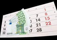 Calendar and euro. Calendar and several one hundred euro bills Royalty Free Stock Photography