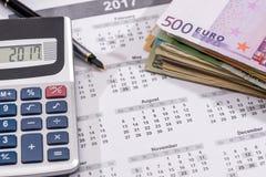 Calendar with euro bills with calculator pen. 2017 calendar with euro bills with calculator pen Royalty Free Stock Photos