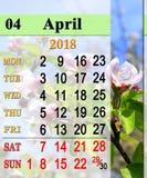 Calendar för April 2018 med det blommande äppleträdet Royaltyfria Bilder