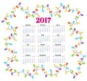 Calendar för 2017 med den färgrika girlandbakgrundsvektorn Arkivfoto