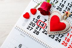 Calendar, February 14, a gift for Valentine`s Day. Engagement ring, heart, calendar, February 14, a gift for Valentine`s Day royalty free stock photo