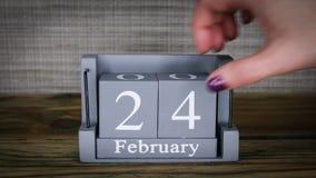 24 calendar February months. 24 setting date on wooden cube calendar for February months stock video