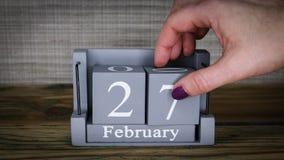 27 calendar February months. 27 setting date on wooden cube calendar for February months stock footage