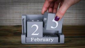 25 calendar February months. 25 setting date on wooden cube calendar for February months stock video footage