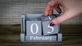 05 calendar February months. 05 setting date on wooden cube calendar for February months stock footage