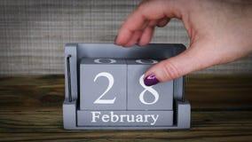 28 calendar February months. 28 setting date on wooden cube calendar for February months stock video
