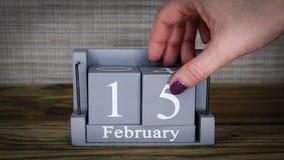 15 calendar February months. 15 setting date on wooden cube calendar for February months stock footage