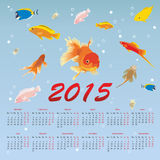 Calendar 2015 with fish. On a blue background stock illustration