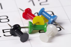 Calendar. Fragment perspective shot with pile of push-pins Royalty Free Stock Image