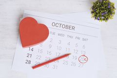 Calendar with gift box. October calendar with red gift box. Date Night, love concept stock photography