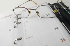 Calendar and glasses wide Stock Image