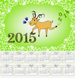 Calendar for 2015 with a goat on a green background Stock Photos