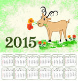 Calendar for 2015 with a goat on grungy backgroun. Goat with flowers on green grungy background with calendar for 2015 Vector Illustration