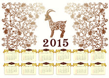 Calendar for 2015 with a goat in vintage style. Calendar in yellow and brown colors for 2015 with a goat in vintage style Stock Illustration