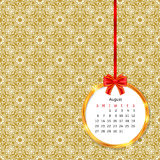 Calendar 2017 in golden circle frame with red bow on vintage decor seamless pattern Stock Photos