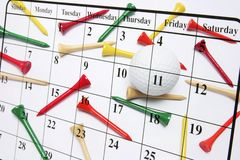 Calendar and Golf Tees Royalty Free Stock Photos