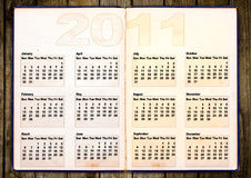 Calendar grid 2011. Year english, grunge book design stock illustration