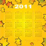 Calendar grid of 2011 year. On autumn-leaf abstract background. English variant. Vector illustration royalty free illustration