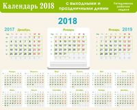 Calendar grid 2018 in Russian with weekends and holidays for a five-day working week. Vector illustration Stock Photos