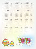 Calendar for Happy New Year 2015 celebrations. Yearly calendar with colorful text 2015 on clouds and X-mas balls for Happy New Year celebrations Stock Image