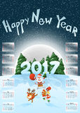 Calendar 2017. Happy New Year. Merry Christmas. Year of the Rooster. Jolly Santa on a sleigh. Deer Santas  and rooster. The symbol. Of the new year. Christmas Royalty Free Stock Photos