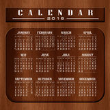 Calendar 2016 and happy new year. Wood Abstract Background, a beautiful wood carving texture Royalty Free Stock Photos
