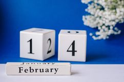 Calendar happy Valentine`s Day on a blue background royalty free stock photography