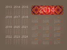 Calendar 2014. Holiday calendar for 2014 on a beige background with a floral pattern Stock Photos