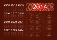Calendar 2014. Holiday calendar for 2014 on a beige background with a floral pattern Stock Image