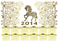 Calendar 2014 with a horse on a vintage background. Vintage style calendar in brown and beige tones with yellow decor for 2014 with a horse Stock Image