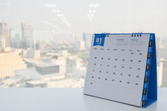 Calendar of January. On the white table with city view background stock photography