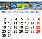 Calendar for January of 2017 with winter landscape. Calendar for January of 2017 with image of snow-covered fence in the village Royalty Free Stock Photos