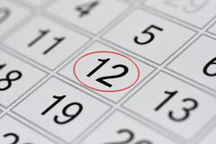 Calendar, mark day of the week, date in the red circle, note, scheduler, memo, save the date, 12. Calendar mark day of the week, date in the red circle, note Royalty Free Stock Images