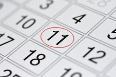 Calendar, mark day of the week, date in the red circle, note, scheduler, memo, save the date, 11. Calendar mark day of the week, date in the red circle, note Royalty Free Stock Photography