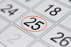 Calendar, mark day of the week, date in the red circle, note, scheduler, memo, save the date, 25. Calendar mark day of the week, date in the red circle, note Royalty Free Stock Photos