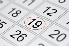 Calendar, mark day of the week, date in the red circle, note, scheduler, memo, save the date, 19. Calendar mark day of the week, date in the red circle, note royalty free stock image