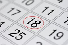 Calendar, mark day of the week, date in the red circle, note, scheduler, memo, save the date, 18. Calendar mark day of the week, date in the red circle, note Royalty Free Stock Image